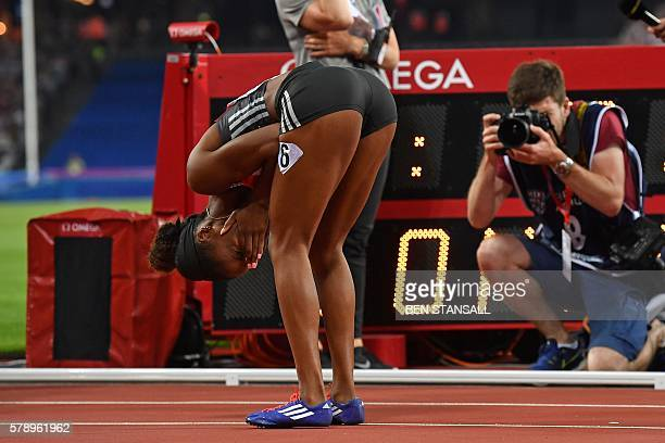 US athlete Kendra Harrison reacts after realising she's broken the world record after she wins the final of the women's 100m hurdles at the IAAF...
