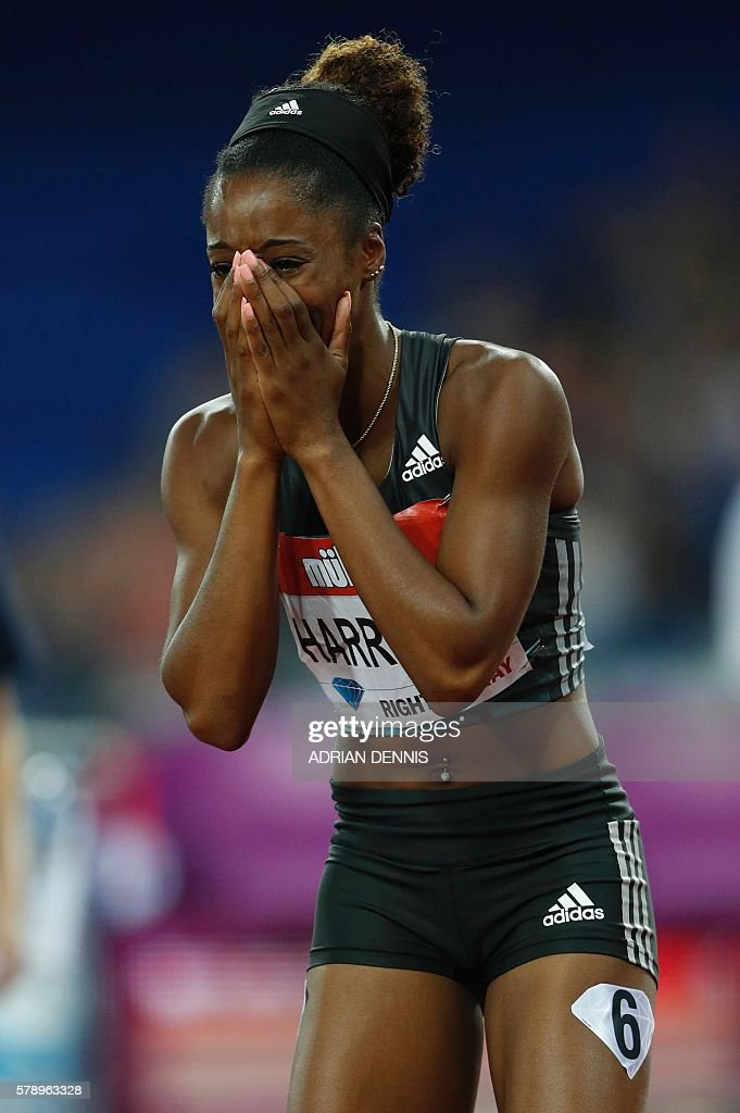US athlete Kendra Harrison reacts after realising she's broken the world record after she wins the final of the women's 100m hurdles at the IAAF Diamond League Anniversary Games athletics meeting at the Queen Elizabeth Olympic Park stadium in Stratford, east London on July 22, 2016. / AFP / Adrian DENNIS