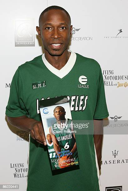 Athlete Kenny Lofton shows off custommade Jose Cuervo Platino box with his image on it as he attends the ELeague Jose Cuervo Super Saturday on April...