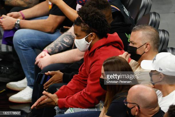 Athlete Kyler Murray of the Arizona Cardinals attends Game Two of the Western Conference second-round playoff series between the Denver Nuggets and...
