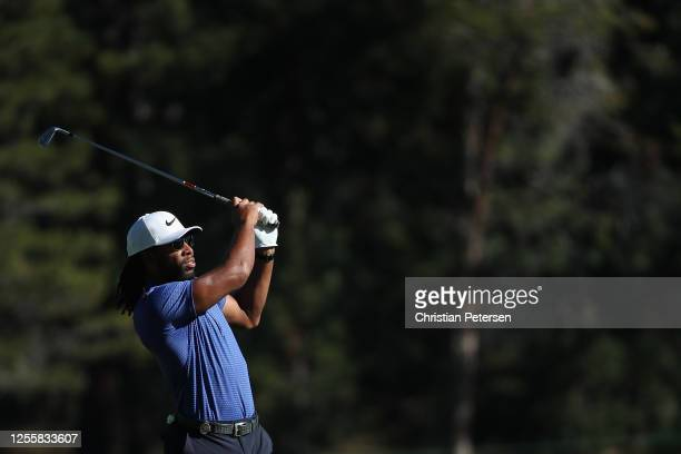 NFL athlete Larry Fitzgerald of the Arizona Cardinals plays his second shot on the first hole during the final round of the American Century...