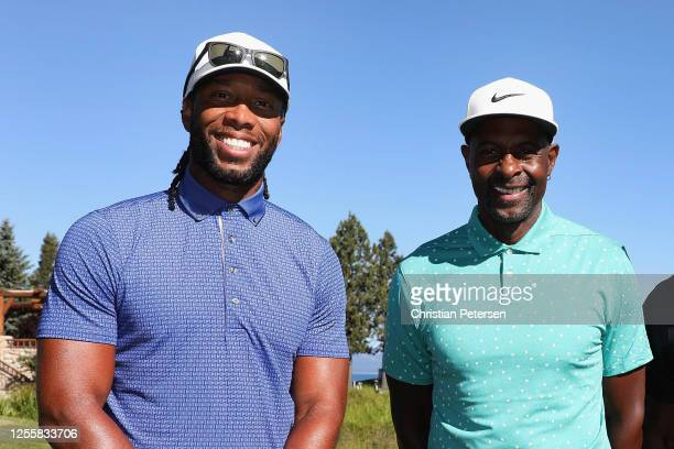 NFL athlete Larry Fitzgerald of the Arizona Cardinals poses with former NFL athlete Jerry Rice primarily with the San Francisco 49ers during the...