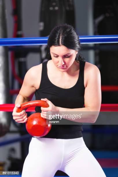 Athlete lifing kettlebell