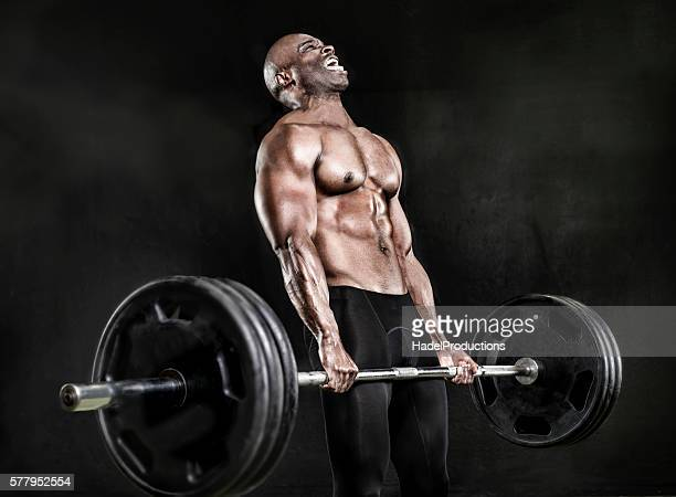 athlete lifting heavy weights - bodybuilding stock-fotos und bilder