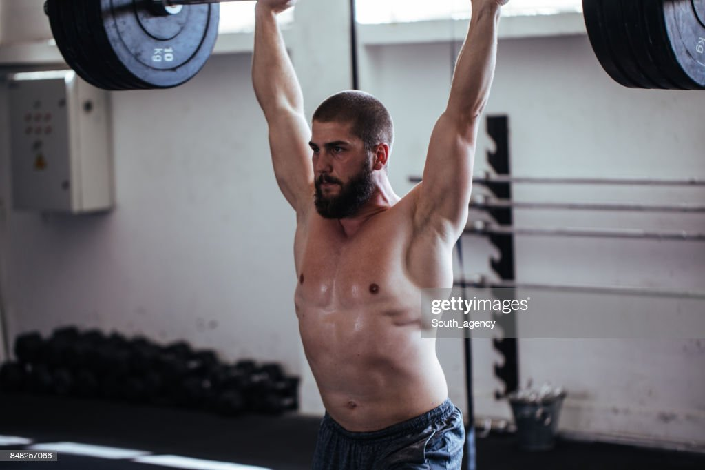Athlete lifting weights : Stock Photo