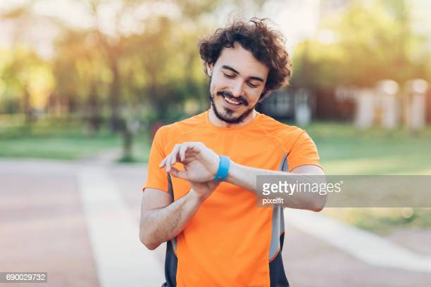 Athlete looking at his smart watch