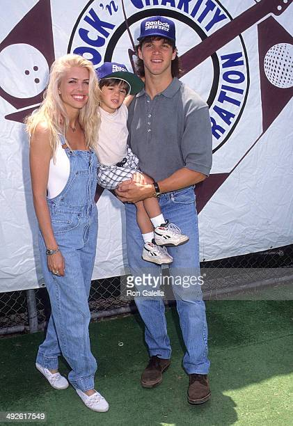 Athlete Luc Robitaille girlfriend Stacey Toten and her son Steven McQueen on June 14 1992 at Dedeaux Field USC in Los Angeles California