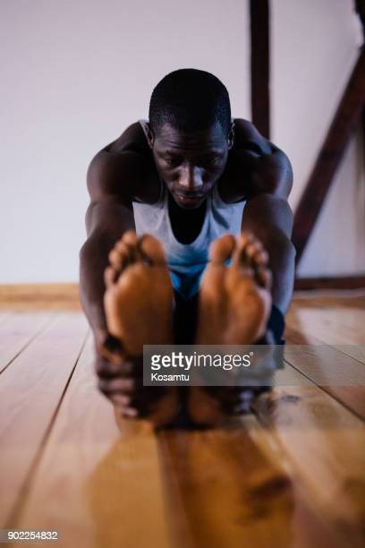 athlete man stretching before training - black male feet stock photos and pictures