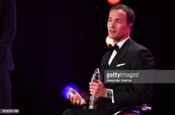Athlete Marcel Hug speaks on stage after winning the Laureus World Sportsperson of the Year with a Disabilty 2018 Award during the 2018 Laureus World...
