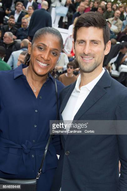 Athlete MarieJose Perec and Tennis Player Novak Djokovic attend the Lacoste show as part of the Paris Fashion Week Womenswear Spring/Summer 2018 at...