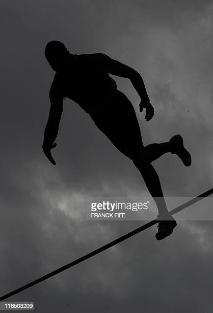 US athlete Mark Hollis competes during the pole vault event at the IAAF Diamond League athletics Areva meeting on July 8 2011 at the Stade de France...