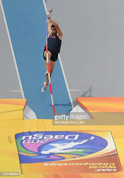 US athlete Mark Hollis competes in the men's pole vault qualification round at the International Association of Athletics Federations World...