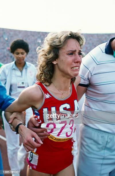US athlete Mary Decker sustains a hip injury after colliding with Zola Budd during the Women's 3000 Metres Final at the Olympic Games in Los Angeles...