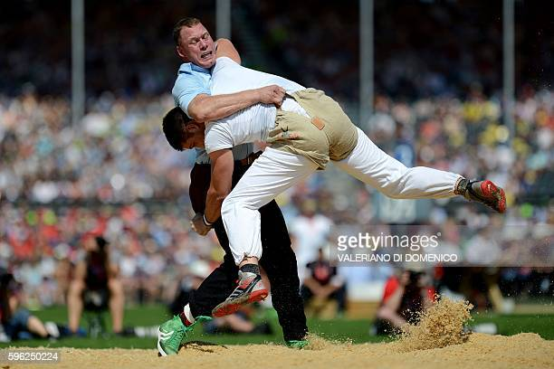 Athlete Matthias Sempach fight against Marcel Bieri during the first day of the Federal Alpine Wrestling Festival on August 27 2016 in Payerne...
