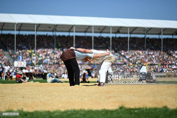 Athlete Matthias Sempach fights against Marcel Bieri during the first day of the Federal Alpine Wrestling Festival on August 27 2016 in Payerne...
