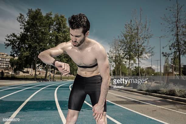Athlete measuring pulse