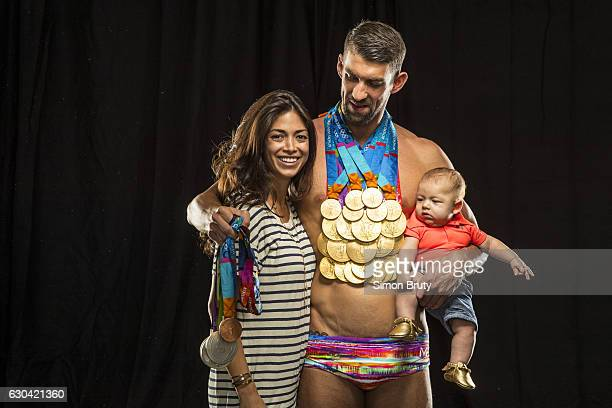 Athlete Michael Phelps poses with his Olympic medals 28 in all 23 gold for Sports Illustrated on August 29 in New York City Phelps stands with his...