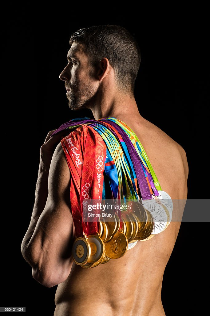 5f4eea0c4c Michael Phelps, Sports Illustrated, December 26, 2016. Athlete Michael  Phelps poses with his Olympic medals, 28 in all ...
