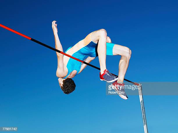 Athlete mid air high jumping