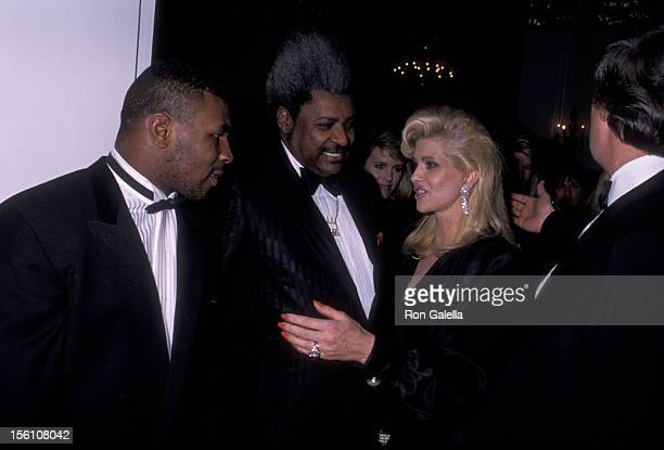 Athlete Mike Tyson Boxing Promoter Don King Ivana Trump and businessman Donald Trump attend Gourmet Gala Benefiting March of Dimes on November 21...