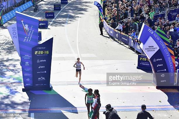 Athlete Molly Huddle wins third place as the top American finisher with TAG Heuer Official Timekeeper for The New York City Marathon on November 6,...