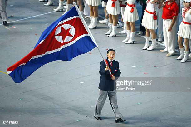 Athlete Mun Il Pang Mun of North Korea carries his nation's flag during the Opening Ceremony for the 2008 Beijing Summer Olympics at the National...