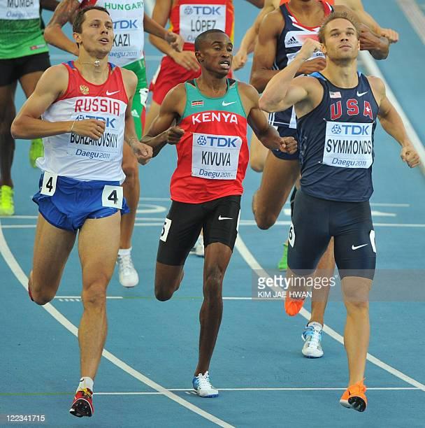 US athlete Nick Symmonds punches the air after finishing next to Russia's Yuriy Borzakovskiy and Kenya's Jackson Mumbwa Kivuva in their men's 800...