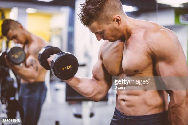 Athlete on steroids exercising in gym