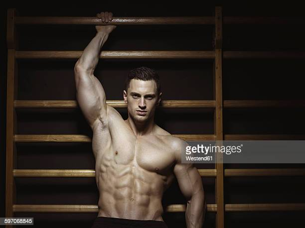 Athlete on wall bars