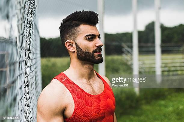Athlete outdoors looking sideways