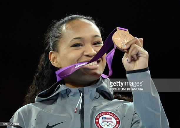 US athlete Paige Mcpherson poses with her bronze medal during the victory ceremony for the women's taekwondo under 67 kg category of the London 2012...