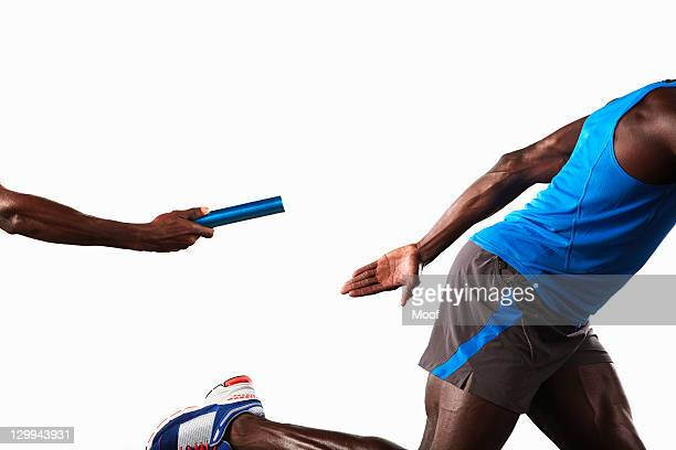 Athlete passing relay baton