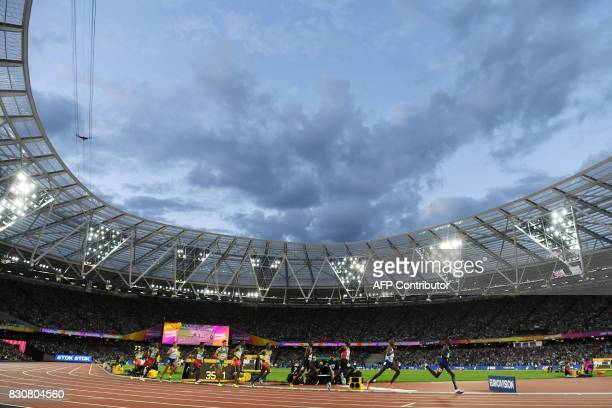 US athlete Paul Kipkemoi Chelimo Britain's Mo Farah and Kenya's Cyrus Rutto run at the head of the pack in the final of the men's 5000m athletics...