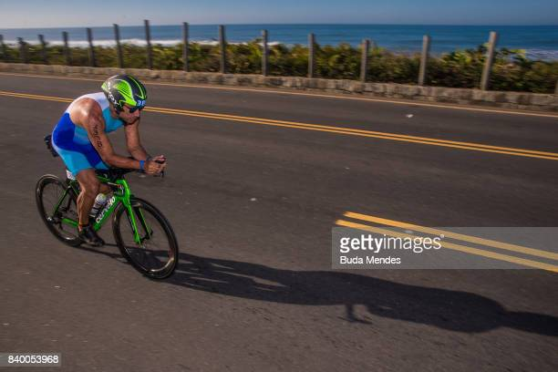 Athlete Paulo Augusto Moura Jr competes in the bike leg during the Rio Triathlon 2017 at Recreio Beach on August 27 2017 in Rio de Janeiro Brazil