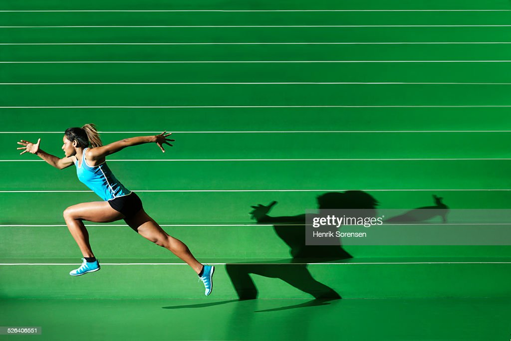 AThlete performing in green sportsarena : Stock Photo
