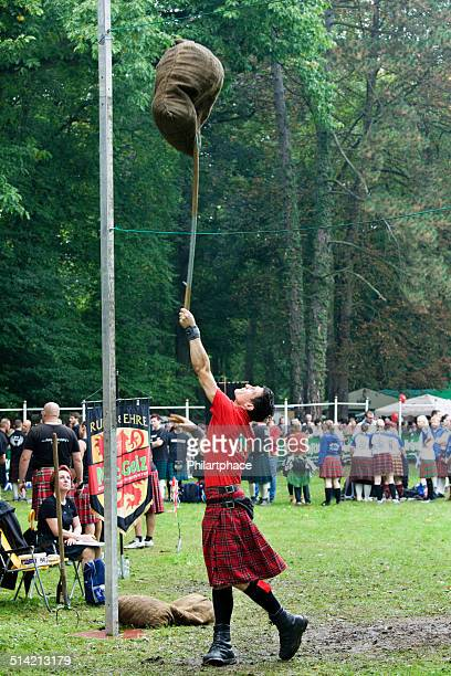 athlete performing Sheaf Toss at Highland Games in Trebsen