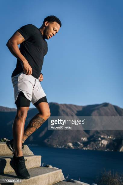 athlete performs training routine while outdoors - boxing shorts stock pictures, royalty-free photos & images