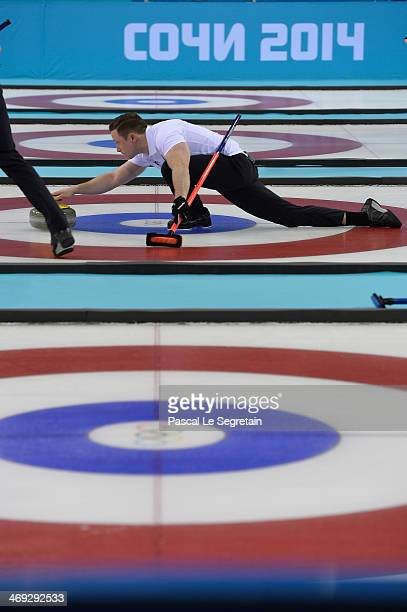 Athlete Peter Rickmers of Germany competes in the men's round robin session against the USA during day seven of the Sochi 2014 Winter Olympics at Ice...