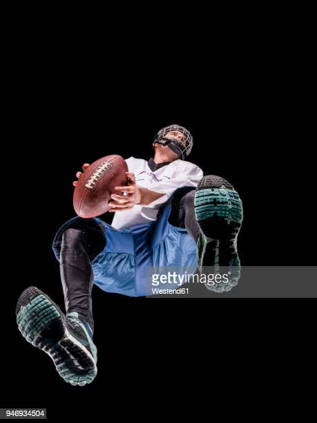 Athlete playing football, view from below