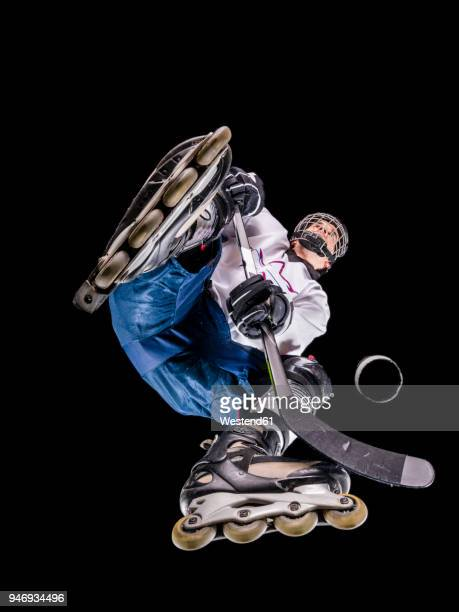 athlete playing roller hockey, view from below - 真下からの眺め ストックフォトと画像