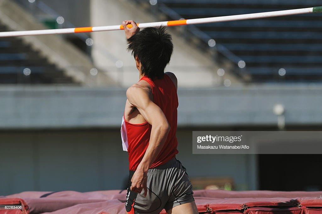 Athlete Preparing to Jump : Stock Photo
