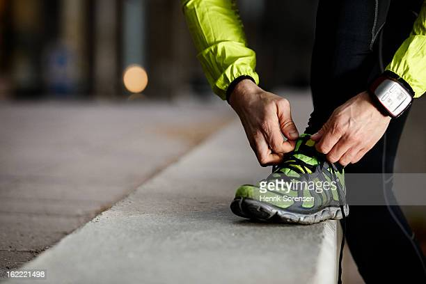 athlete preparing work out - shoelace stock pictures, royalty-free photos & images