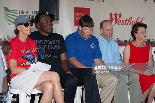 Athlete Rafer Johnson and guests speak on stage during the Special Olympics Southern California 14th Annual Pier Del Sol Event at Santa Monica Pier...