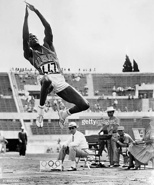 Athlete Rafer Johnson competes in the men's decathlon long jump qualifications at the athletics event of the Rome 1960 Olympic Games, on September...