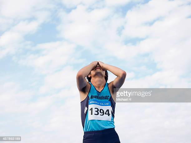 a athlete raising his arm in triumph - defeat stock pictures, royalty-free photos & images