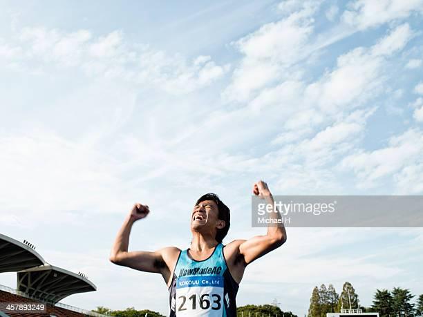 A athlete raising his arm in triumph