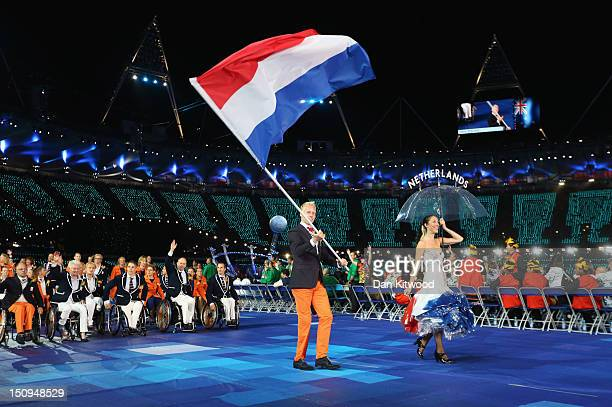 Athlete Ronald Hertog of Netherlands carries the flag during the Opening Ceremony of the London 2012 Paralympics at the Olympic Stadium on August 29...