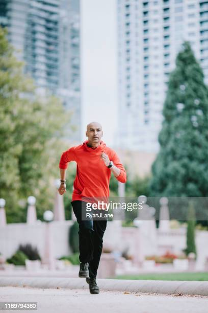 athlete running in bellevue city park - bellevue skyline stock pictures, royalty-free photos & images