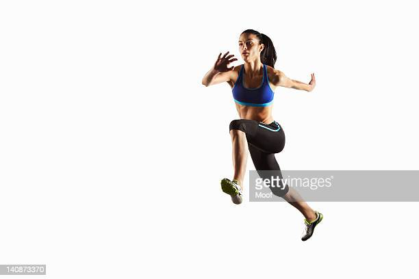 athlete running in mid air - athlete stock pictures, royalty-free photos & images