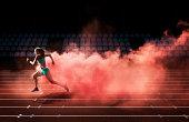 athlete running in red smoke